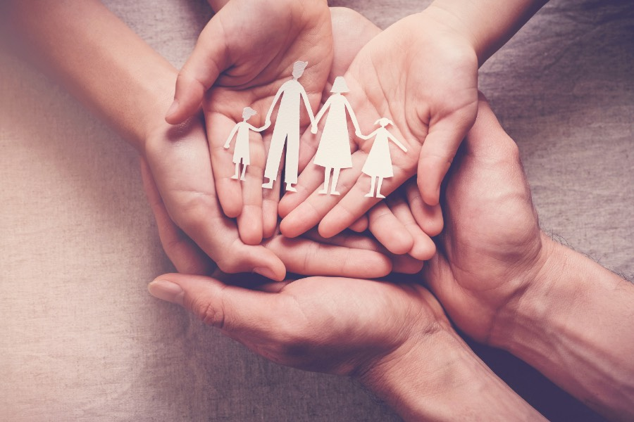 hands with paper cutouts